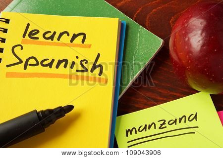 Notebook with learn Spanish  sign. Education concept.
