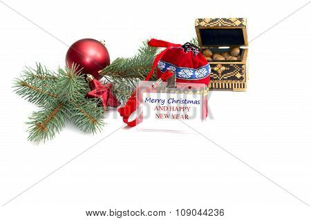 The Plate With An Inscription Christmas, Nutlets And A Coniferous Branch