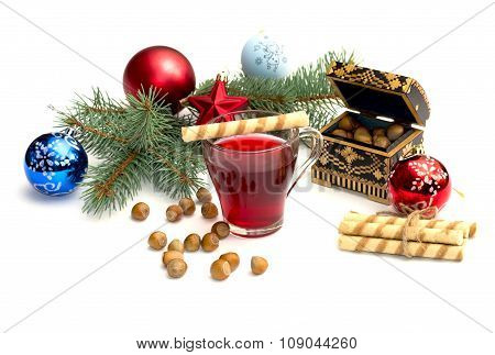 Nutlets, Tea And Coniferous Branch With Christmas Tree Decorations