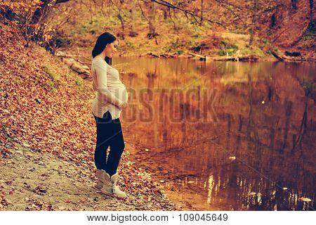 Pregnant Woman Posing Near The Lake