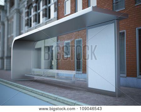 Modern bus stop with blank billboard near brick wall.