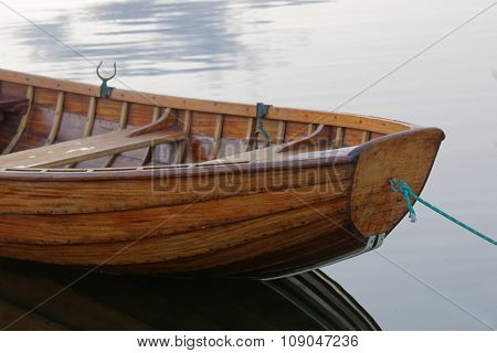 Front Of A Rowboat In Calm Water In The Harbour