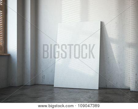 Blank white canvas in the bright loft interior.