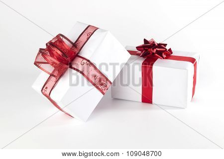 White Presents With Red Ribbons And Bows, Isolated