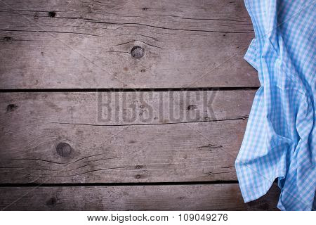 Blue  Checkered Kitchen Towel  On Vintage  Wooden Background.