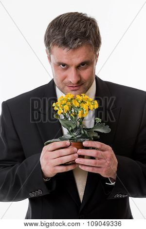 Man holds a flower in  hands.