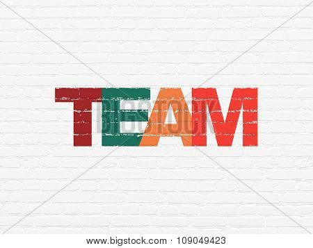 Business concept: Team on wall background