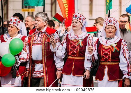 People in national Belarusian folk costume participating in the