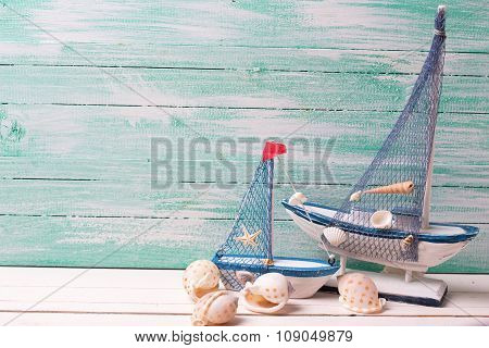 Decorative Sailing Boats And Marine Items On Wooden Background.