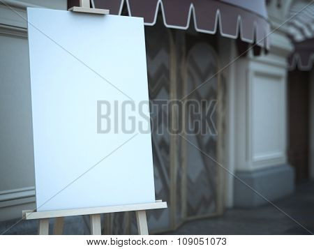 Wooden easel with a blank canvas near cafe.