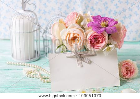 Pink Roses And Violet Clematis Flowers  In Vase, Empty Tag And Candles