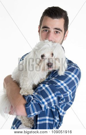Portrait Of A Man Holding A White Dog Maltese Bischon Isolated Over White.