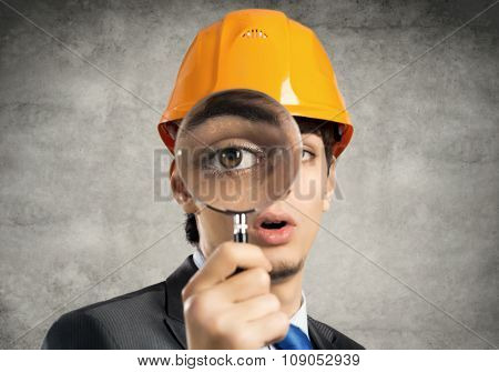 Construction man with magnifier