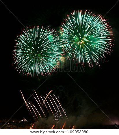Green fireworks, holidays background