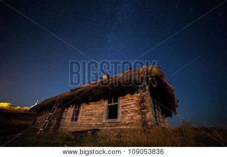Ukrainian House on the background of the Milky Way