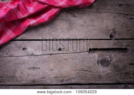 Kitchen Towel  On Vintage  Wooden Background.