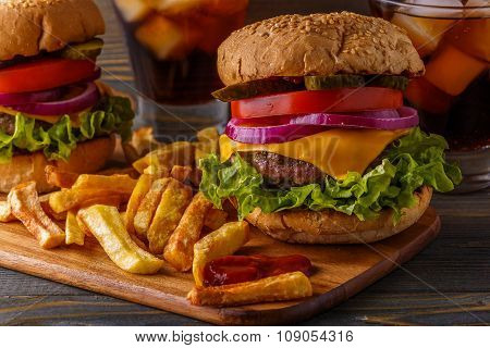 Burger, Hamburger With French Fries And Fresh Vegetables.
