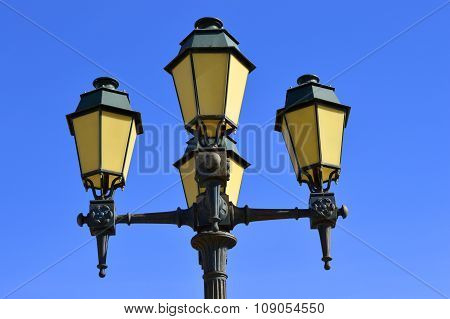 Street lights in Faro old town Portugal