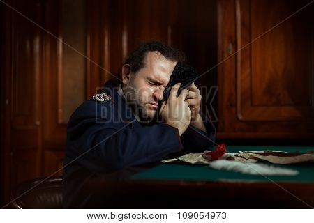 Man Sitting At The Table Crying.