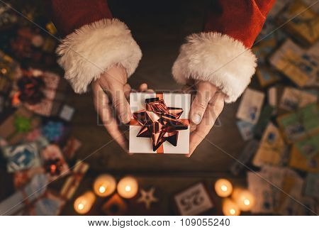 Santa Claus Giving A Christmas Present