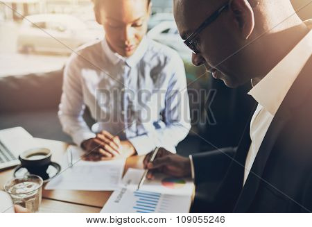 Two Black Business People Discussing Their Business