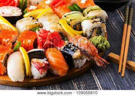 Sushi Set: Sushi And Sushi Rolls On Wooden Plate.