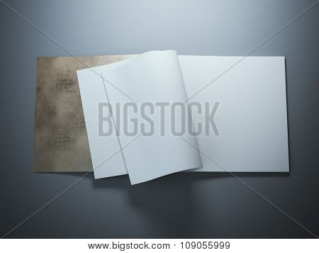 Open blank notebook with curled sheets