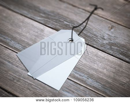Two blank labels with string on the floor.