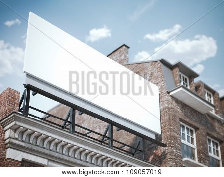 Blank billboard standing on the classic building