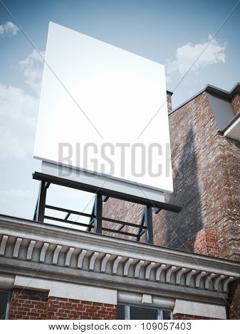 Blank vertical billboard standing on the classic building