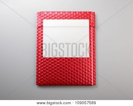 Red metal bubbles packaging bag with sticker