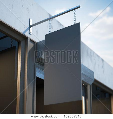 Black blank signboard hanging near shop door.