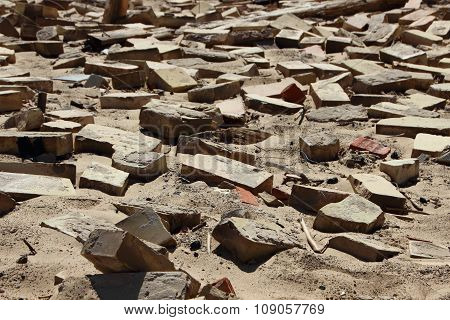 Closeup On Clay Building Brick Tiles In Sand