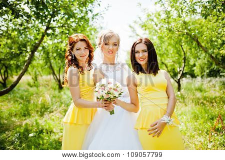 Bride With Bridesmaids At Garden