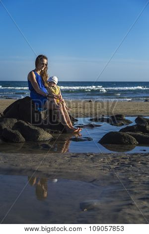 Mother With Daughter Sitting