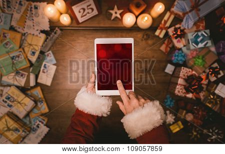 Santa Claus Using A Tablet