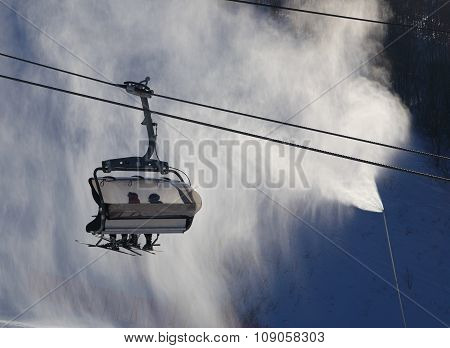 Ski Lift Gondola Against Atomized Artificial Snow