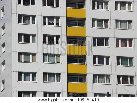 Apartment Building Facade With Yellow Color Balcony
