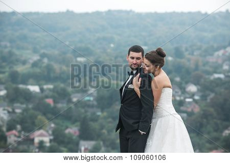 Wedding couple posing for the camera