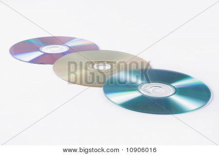 cd and dvd over white background