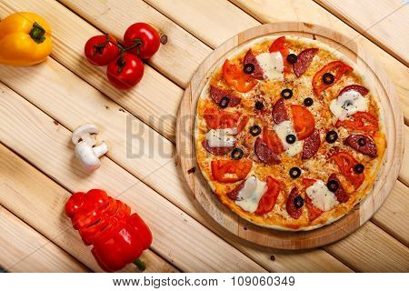 Pizza on light wooden background top view