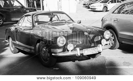Dark Old-timer Volkswagen Karmann Ghia Stands