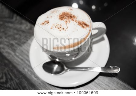 Cup Of Coffee With Milk Foam And Cinnamon