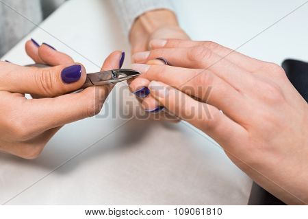 Nail technician perfom procedure hand care
