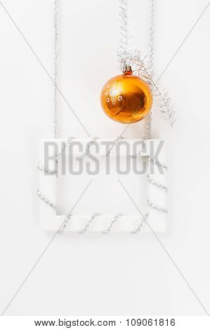 Greeting Card Template Made Of White Frame With Silver Tinsel And Orange Ball