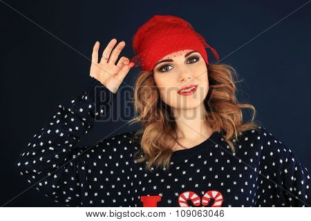 beautiful woman in herd hat and Christmas theme sweater