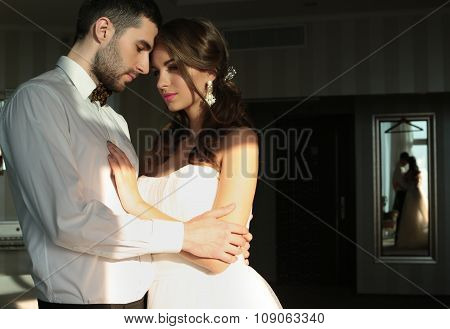 Beautiful Couple, Groom And Bride Wear Wedding Clothes,embracing  In Bedroom