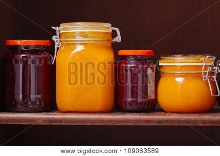 Jars of jam on a shelf