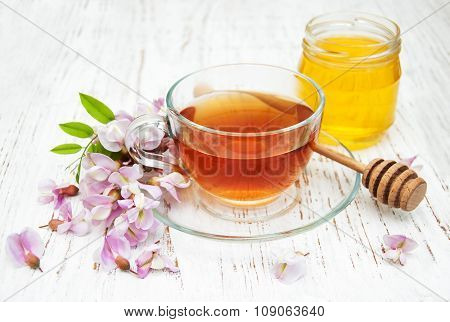Cup Of Tea And Acacia Flowers