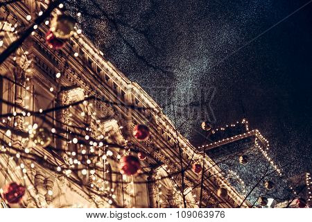 Snowfall during christmas night in europe town